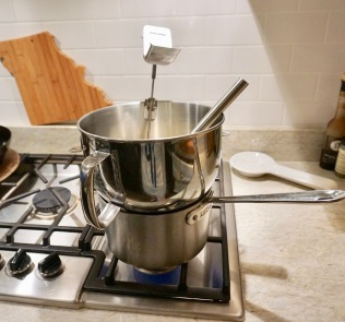 Whisking the egg & sugar mixture over the double boiler with a candy thermometer